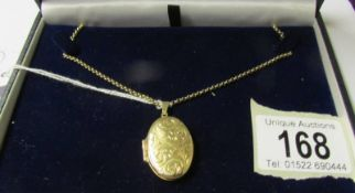 A 9ct gold locket and chain. 8.8 grams.