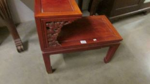 A Chinese style telephone seat.