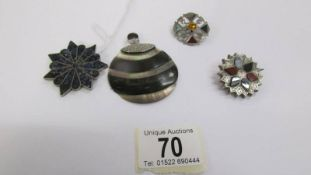 Two Scottish silver multi agate brooches together with a silver brooch and a silver pendant.
