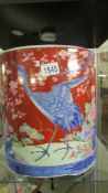 A large Chinese plant pot hand painted with storks.