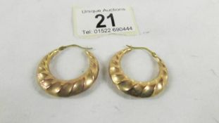 A pair of 9ct gold earrings, 4 grams.