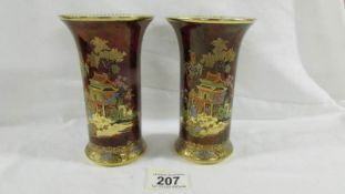 A pair of beautiful 15 cm tall hand enamelled and painted Carlton ware vases with markings to base.