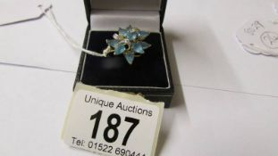 A 9ct gold blue stone dress ring, size P half.