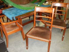 A mahogany dining table with 4 chairs.