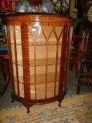 A domed front display cabinet.