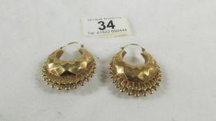 A pair of 9ct gold earrings, 7 grams.