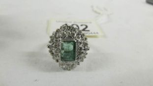 A 14ct white gold 1.75 emerald and 1.8 diamonds ring, size P.