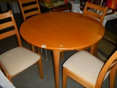 A circular table and 4 chairs.