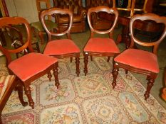 A set of 4 mahogany dining chairs.