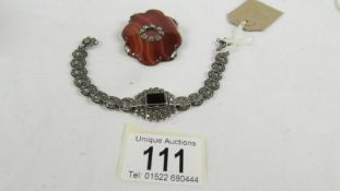 A banded agate Scottish brooch circa 1940's together with a silver marcasite set bracelet.