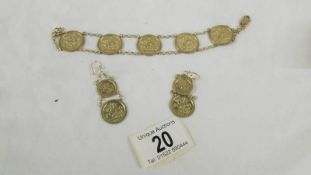 A 9ct gold bracelet with 5 St. George medallions and a matching pair of pendant earrings. 12.
