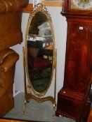 A Regency style cheval mirror.