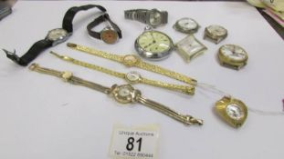 A Longines wrist watch in yellow metal together with a collection of other watches including pocket