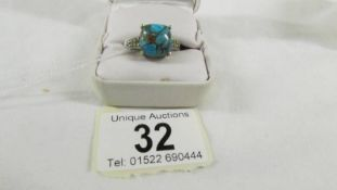 A silver ring set turquoise stone,size U.