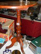 A mahogany tripod table.