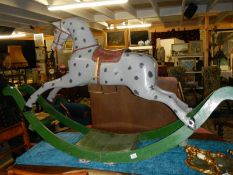 A large early rocking horse on bowed rockers.
