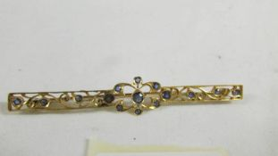 A stone set brooch. ( tests as 24ct gold).