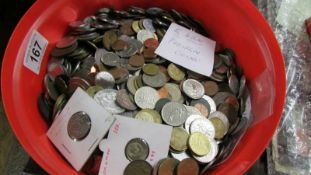 Approximately 5 kilos of foreign coins.