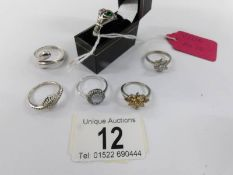 Six silver rings including a Claddagh ring.