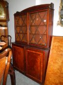 A mahogany inlaid glazed top bookcase.
