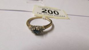 A 9ct gold diamond and topaz dress ring, size T.