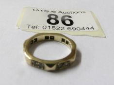 A 9ct gold eternity ring, size K.