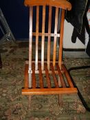 A folding campaign chair.