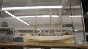 A large cased model three mast sailing boat.
