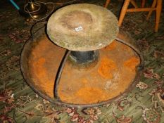An old cast iron pig feeder.