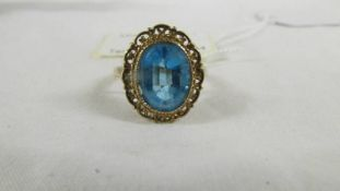 A 9ct gold ring set large blue stone, size T.