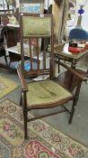 A mahogany inlaid high back elbow chair.