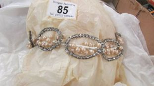 A circa 1950's pearl set wedding tiara with long veil.