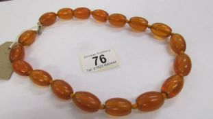 A large bead amber necklace with 9ct gold clasp.