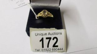 An 18ct gold antique champagne diamond solitaire ring, size Q.