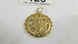 A pendant (test and 24 ct gold) 2.6 grams.