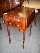A Victorian 2 drawer work table with drop sides.