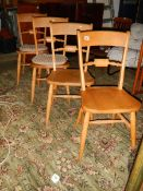 A set of 4 pine kitchen chairs.