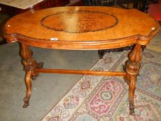 A mid 19th century walnut marquetry inlaid table (some inlay a/f).