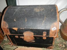 A domed top fabric covered chest.
