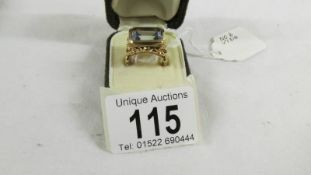 A vintage fancy work gold ring set with pale blue stone. Open gold work sides, 8.