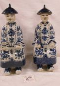 A pair of Chinese Republic blue and white seated figures, Fujian Guild/Club stamp to base.