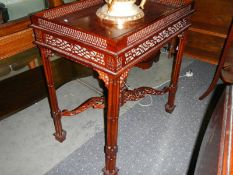 A mahogany galleried table. ****Condition report**** No missing or broken fretwork.