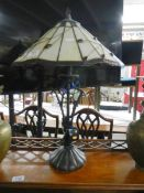 A table lamp with Tiffany style shade.