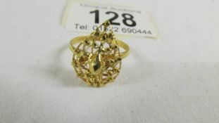 A fretwork ring, size N half, (tests a 24ct gold), 3.5 grams.