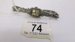 A silver ladies wrist watch set with marcasite, circa 1940/50's, in working order.