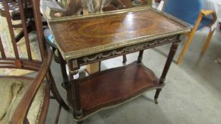 A French ormolu inlaid side table with brass gallery.