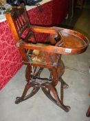 A Victorian metamorphic high chair.