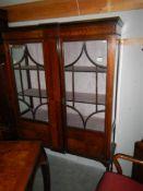 An Edwardian mahogany inlaid display cabinet.