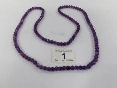 A natural amethyst long necklace.