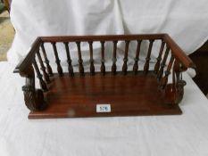 A mahogany book rack. ****Condition report**** Late 20th century.